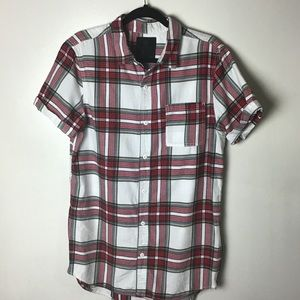 On the Byas red plaid s/s button up shirt. Medium